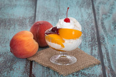 Vanilla peach melba ice cream with peach fruits Stock Photo
