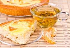 Vanilla pie and slices of mandarin and tea Stock Image