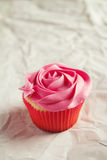 Vanilla and pink rose piping pretty cupcake Royalty Free Stock Image