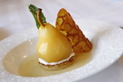 Vanilla Poached Pear with Frangipane Stock Photos
