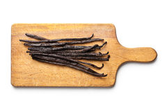 Vanilla pods on chopping board Royalty Free Stock Photos