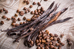 Vanilla pods and coffee beans Royalty Free Stock Image