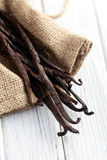 Vanilla pods on kitchen table Royalty Free Stock Photo