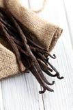 Vanilla pods on kitchen table Royalty Free Stock Photo