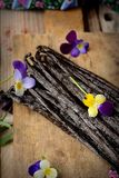 The vanilla pods on kitchen table Royalty Free Stock Photos