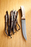 Vanilla pods with knife Royalty Free Stock Photos