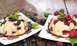 Vanilla Pudding with Berries Stock Photo