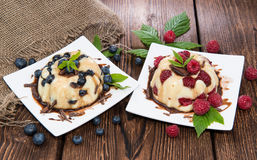 Vanilla Pudding with Berries Stock Photography
