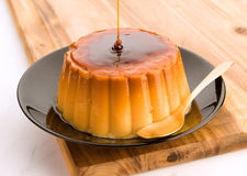 Vanilla pudding in black plate Royalty Free Stock Photo