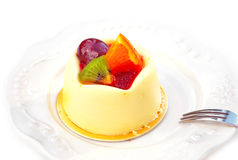 Vanilla pudding with fruit. On a white background stock images