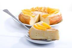 Vanilla pudding pie. Big celebratory vanilla pudding pie with peach segments Stock Photo