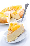 Vanilla pudding pie. Big celebratory vanilla pudding pie with peach segments Stock Photography