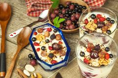 Vanilla pudding with summer fruit on a wooden table. Healthy snacking for kids. royalty free stock image