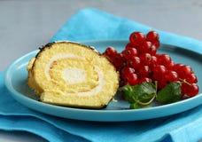 Vanilla roll cake with chocolate ganache Stock Image