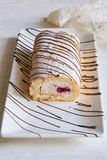 Vanilla roll cake with cream and raspberry stock photography