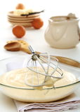 Vanilla sauce in a bowl and whisk for whipping. Stock Photography