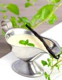 Vanilla sauce with mint stock image