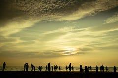 Vanilla sky silhouette on the ocean coast Royalty Free Stock Image