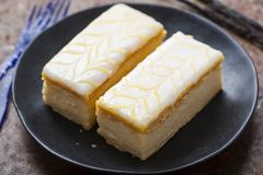 Vanilla slices. Puff pastry filled with vanilla custard topped with fondant icing. Royalty Free Stock Photography