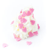 Vanilla soft ice cream decorated with sweet hearts on white Stock Photo