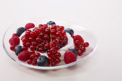 Vanilla souffle and berries on wooden background Royalty Free Stock Photos
