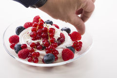 Vanilla souffle and berries on wooden background Stock Photo
