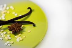 Vanilla stars. On the plate with vanilla pod stock images