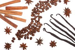 Vanilla sticks, cinnamon, coffee beans and star anise isolated on white background. Composition Stock Photo