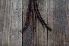 Vanilla sticks on the wood. Group of vanilla sticks on the wood background Stock Photography