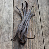 Vanilla sticks on the wood Royalty Free Stock Image
