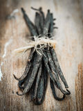 Vanilla. Sticks on a wooden rustic table royalty free stock images