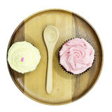 Vanilla and strawberry cup cake top view. On wood plate and white background Royalty Free Stock Photo