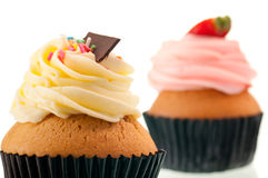 Vanilla and strawberry cupcake at the background Royalty Free Stock Image