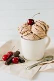 Vanilla sundae ice cream with sweet cherry and chocolate in cup Stock Photos