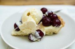 Vanilla tart with fresh cherries. And ice cream Stock Photography