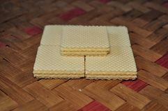 Vanilla wafer  isolated on woven bamboo background stock images