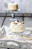 Vanilla wedding cake on cake stand Royalty Free Stock Image