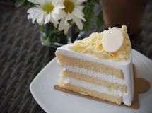 Vanilla and wipping cream cake with white chocolate on topping.  Royalty Free Stock Image