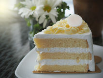 Vanilla and wipping cream cake with white chocolate on topping.  Stock Photos