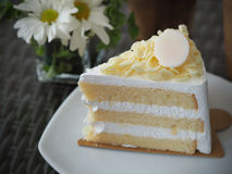 Vanilla and wipping cream cake with white chocolate on topping.  Stock Photo