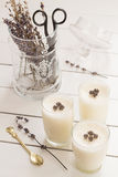 Vanilla Yogurt Panna Cotta with Dried Lavender Flowers. And Scissors in a Glass Jar Royalty Free Stock Photos