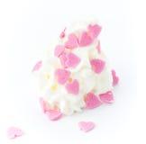 Vanille zacht die roomijs met liefjes op wit wordt verfraaid Stock Foto