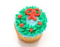 Vanillekleiner kuchen mit grün-blauer und orange Vereisung Lizenzfreie Stockfotos