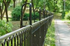 Vanishing decorative wrought iron fence Royalty Free Stock Images