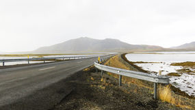 Vanishing Road. Road across a lake in Iceland Stock Image