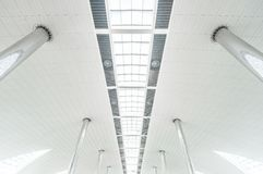 Metal columns and modern glass ceiling at airport. Royalty Free Stock Photo