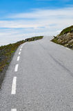 Vanishing winding desert road to heaven. In Norway Stock Photo