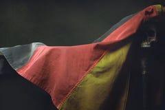 Vanitas of the german Flag with human Skull Royalty Free Stock Image