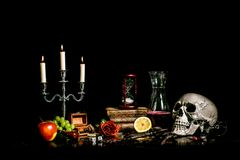 Vanitas Still life - Memento Mori. In a vanitas still life symbolism plays an important role. Items such as a skull, a candle, decayed books, fruits, soap royalty free stock image