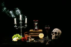 Vanitas Still life - Memento Mori. In a vanitas still life symbolism plays an important role. Items such as a skull, a candle, decayed books, fruits, soap stock photo